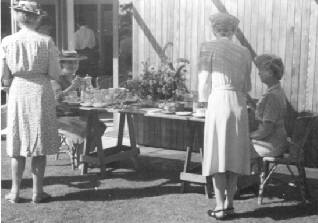 Photo of Bess Harris and  Grace Flather at Bert Binnings 1949 Federation of Canadian Artist's Tea Party