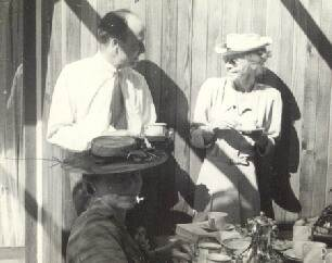 Photo of Jack Shadboltand Grace Flather at Bert Binnings 1949 Federation of Canadian Artist's Tea Party
